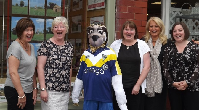 Wolfie with some of the team from our Stockton Heath office